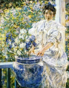 Robert Reid-Woman on a Porch with Flowers 1906